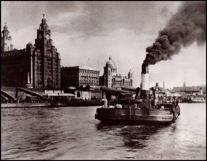 A picture of the ferry crossing the Mersey from New Brighton back to the Pier Head. The Liver Building is in view.