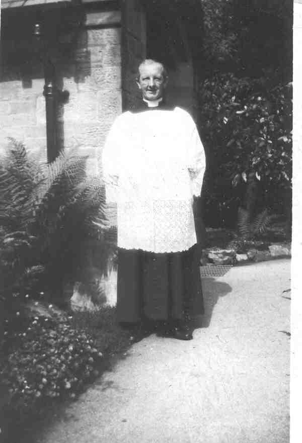 Picture of the Reverend Father John Felix Sulllivan standing outside his church, St Mary's at Fernyhalgh