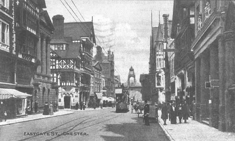 Eastgate Street Chester, circa early 1900's, looking toward the East Gate. The jewelers shop was in the building standing proud to the right next the Gate.